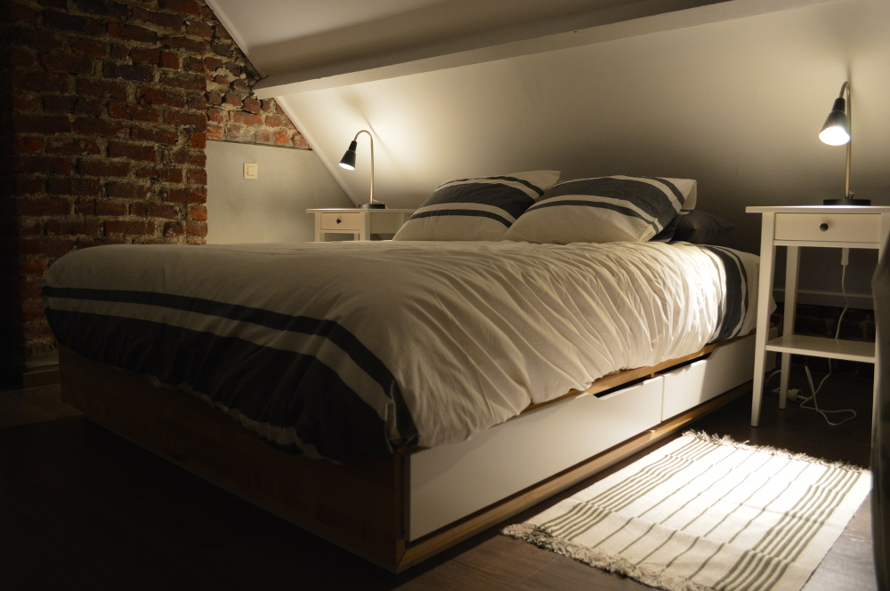 The double bed in the attic bedroom.